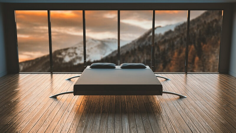 lit devant baie vitrée